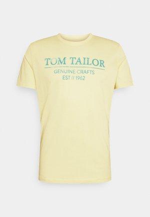 T-shirt print - pale straw yellow