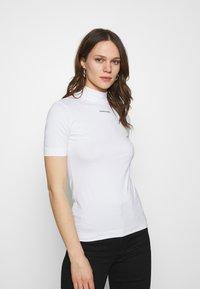 Calvin Klein Jeans - MICRO BRANDING STRETCH MOCK NECK - Print T-shirt - bright white - 0
