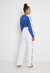 Missguided - PLAYBOY SPORTS WIDE LEG - Tracksuit bottoms - grey marl - 2