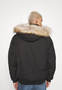 Tommy Jeans - TECH BOMBER UNISEX - Giacca invernale - black - 2