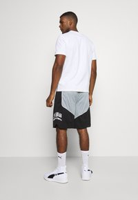Puma - HOOPS HOOPS GAME SHORT - Sports shorts - black - 2