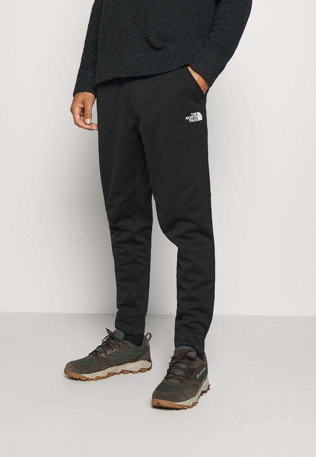 MENS SURGENT CUFFED PANT - Pantalon de survêtement - black