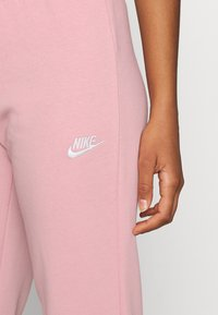 Nike Sportswear - TIGHT - Tracksuit bottoms - pink glaze/white - 4