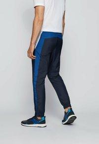 BOSS - Tracksuit bottoms - dark blue - 2