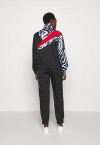 Han Kjøbenhavn - ANIMAL PRINT TRACK - Summer jacket - black - 2