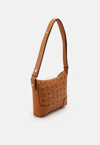 MCM - KLARA SHOULDER BAG IN VISETOS - Handbag - cognac - 1