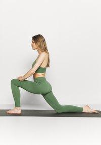 Ellesse - ELIANA - Light support sports bra - green - 1