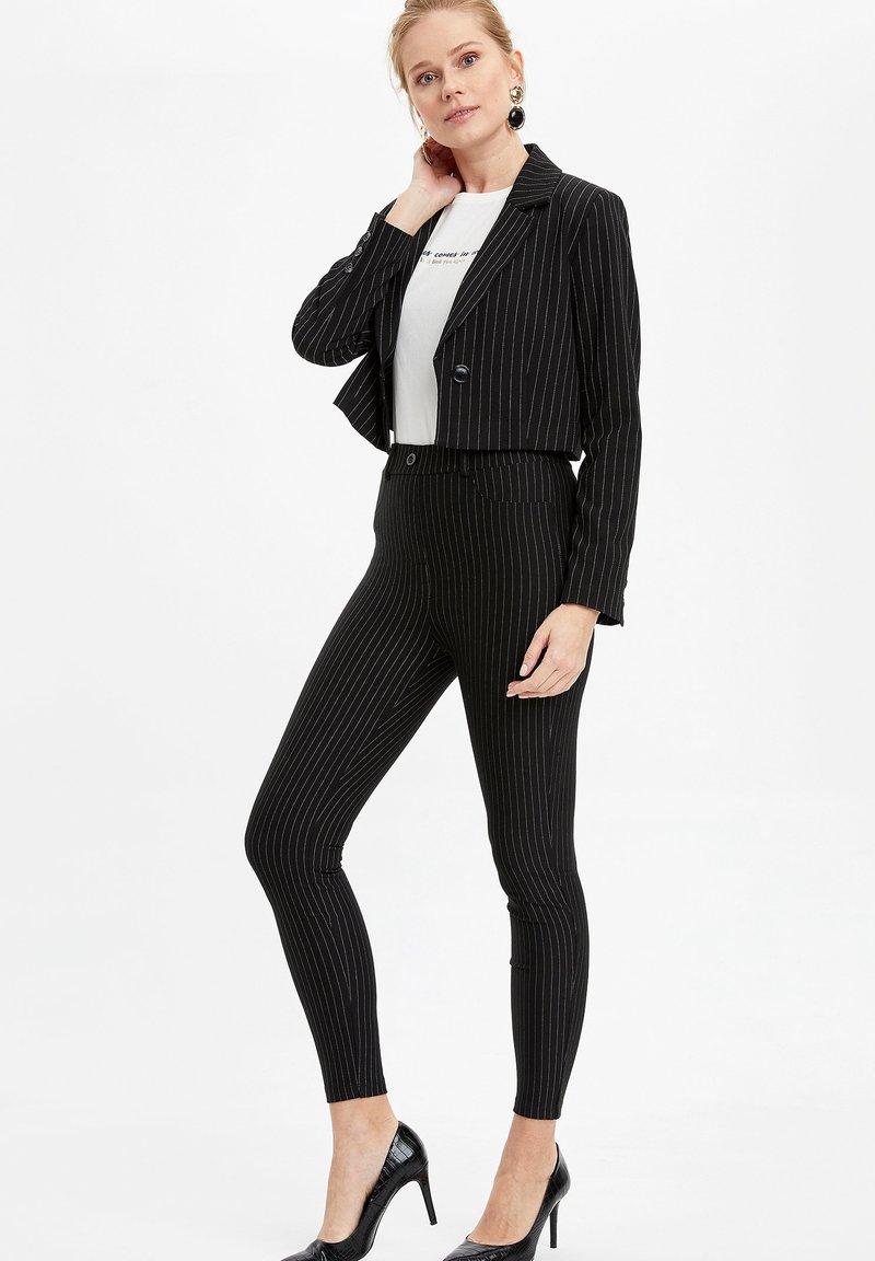 DeFacto - Trousers - black