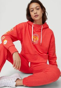 O'Neill - GRAPHIC - Tracksuit bottoms - hot coral - 3