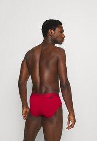 Calvin Klein Underwear - HIP BRIEF 2 PACK - Briefs - red - 1