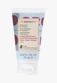 Korres - ALMOND OIL & VITAMIN C ANTI-SPOT HAND CREME SPF15 - Hand cream - - - 0