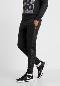 Superdry - COMBAT BOXER JOGGER - Tracksuit bottoms - black - 0