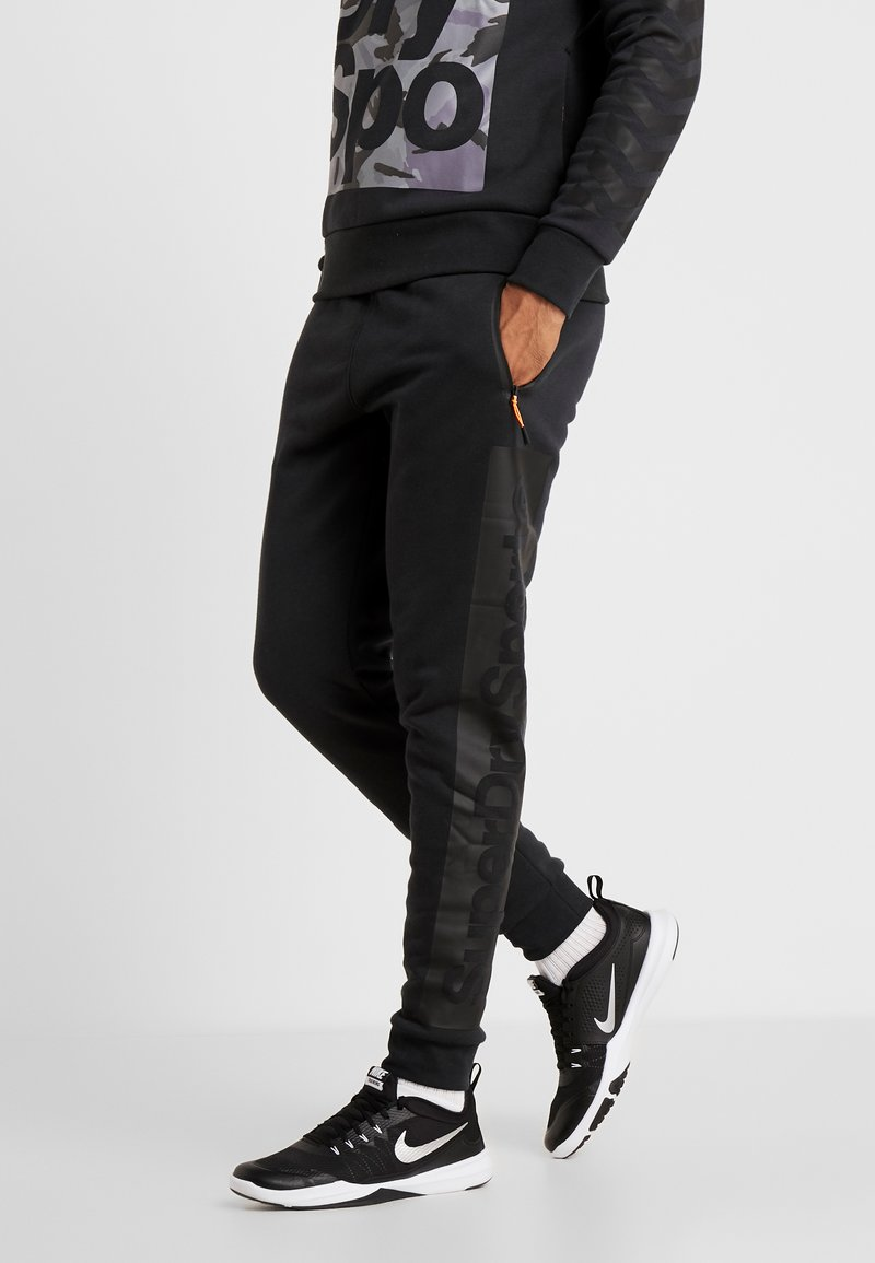 Superdry - COMBAT BOXER JOGGER - Tracksuit bottoms - black