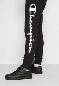 Champion - CUFF PANTS - Pantalon de survêtement - black