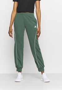 adidas Performance - Tracksuit bottoms - green/white - 0