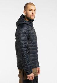 Haglöfs - SPIRE MIMIC HOOD  - Winter jacket - true black - 2