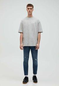 PULL&BEAR - Slim fit jeans - mottled blue - 1