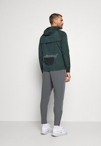 Nike Performance - Sports jacket - seaweed/asparagus/reflective silver - 2