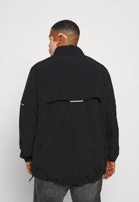 Johnny Bigg - ACTIVE REFLECTIVE LIGHTWEIGHT JACKET - Summer jacket - black - 2