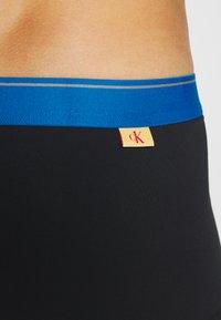 Calvin Klein Underwear - LOW RISE TRUNK - Pants - black - 3