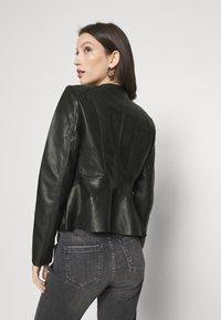 Vero Moda - VMBUTTERALBA COATED JACKET - Faux leather jacket - black - 2