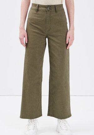 Flared Jeans - vert kaki