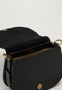 Polo Ralph Lauren - BELT SADDLE - Borsa a tracolla - black - 4