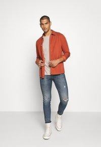 Levi's® Extra - 519™ EXT SKINNY HI-BALLB - Jeans Skinny Fit - tide ride - 1