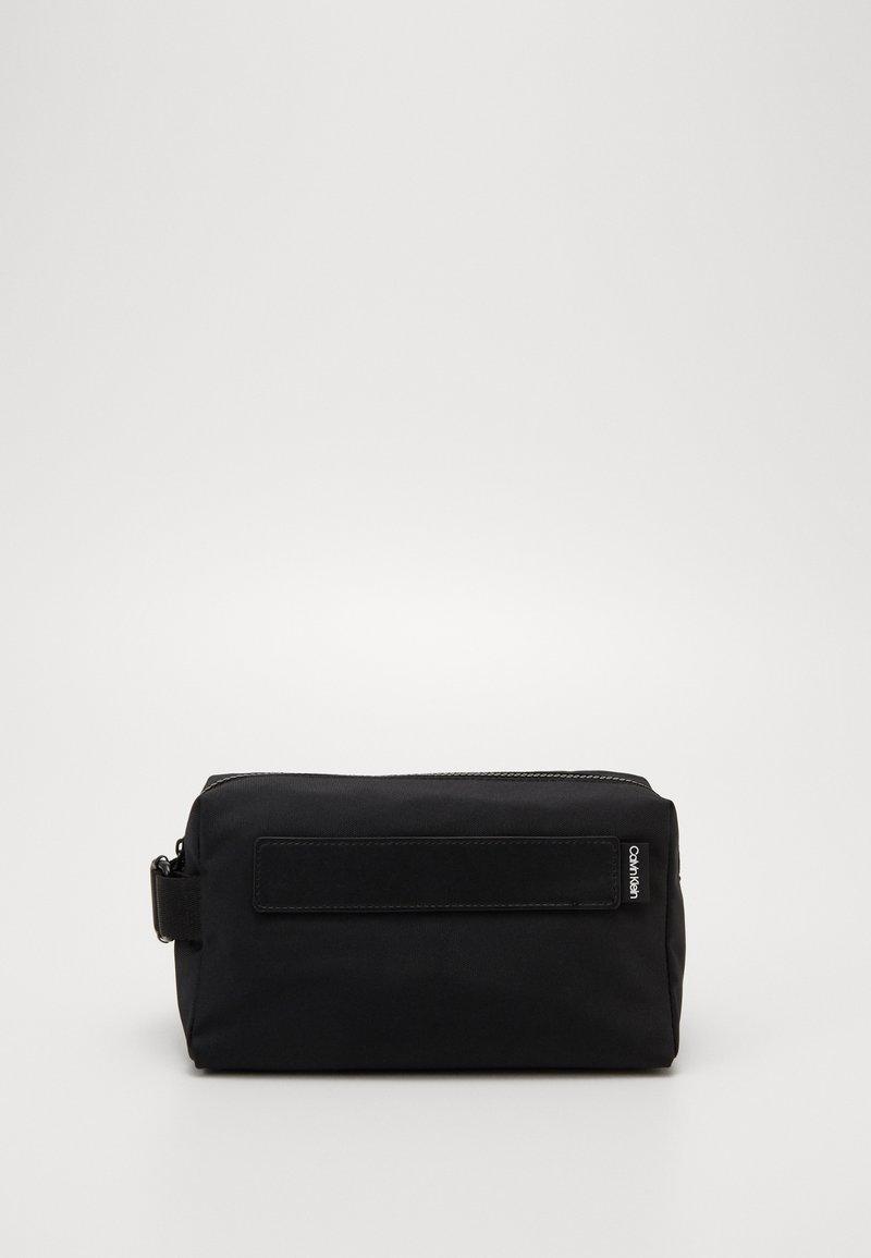 Calvin Klein - NASTRO LOGO WASHBAG - Wash bag - black