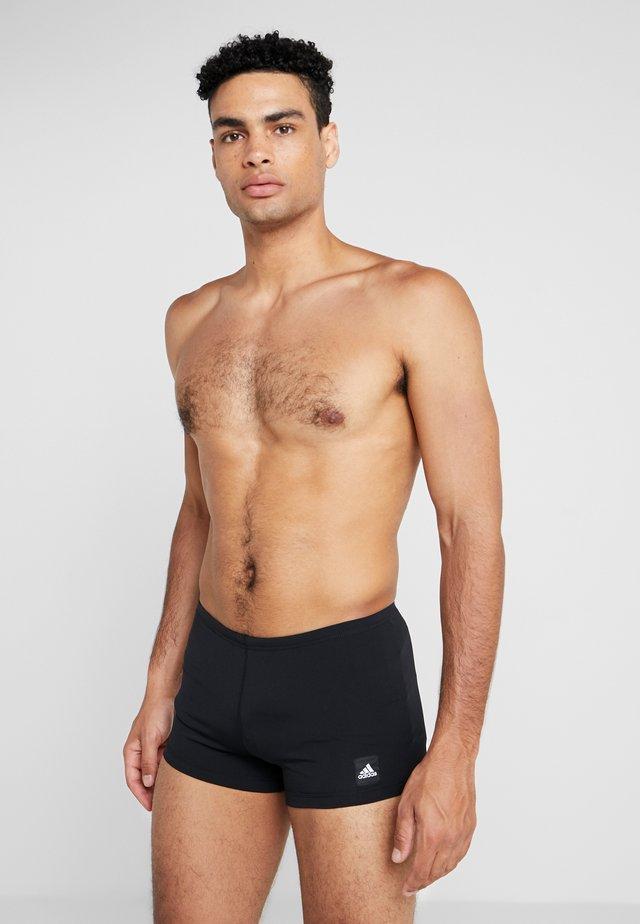 PRO SOLID - Swimming trunks - black/white