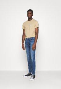 Levi's® - 512™ SLIM TAPER LO BALL - Slim fit jeans - dolf hard knock adv - 1