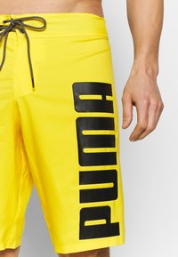 Puma - SWIM MEN LONG BOARD - Swimming shorts - yellow - 4