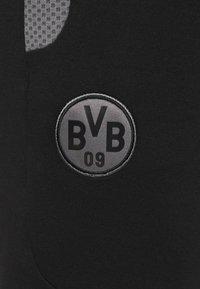 Puma - BVB BORUSSIA DORTMUND EVOSTRIPE PANTS - Tracksuit bottoms - black/castlerock - 6