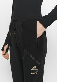 adidas Performance - JAMES BOND ATHLETICS SPORTS PANTS - Tracksuit bottoms - black - 4