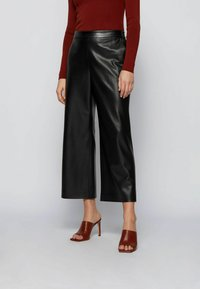 BOSS - TAOMIE - Leather trousers - black - 0
