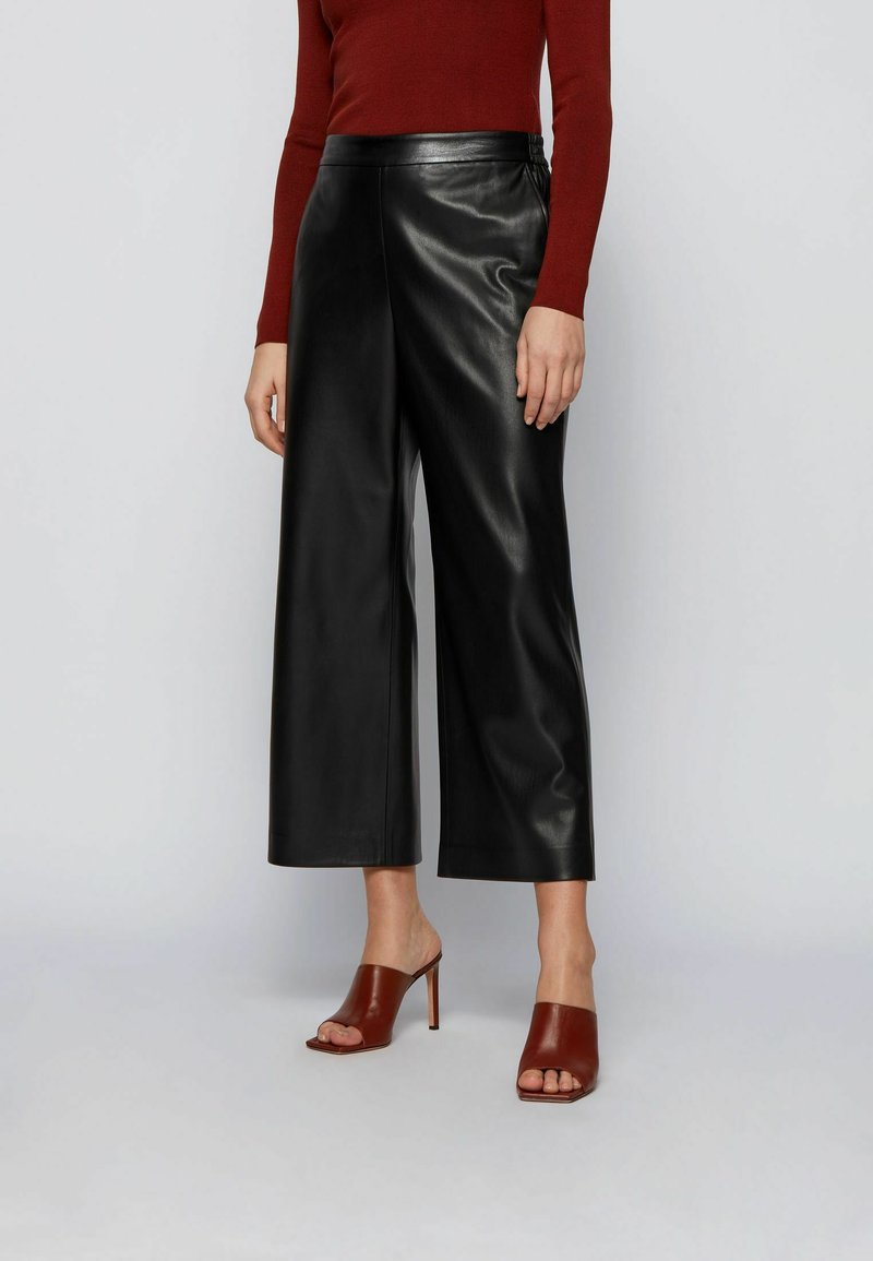 BOSS - TAOMIE - Leather trousers - black