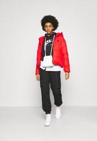Nike Sportswear - CORE  - Light jacket - chile red/white/black - 1