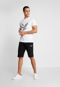 Diadora - BERMUDA CORE LIGHT - Sports shorts - black - 1