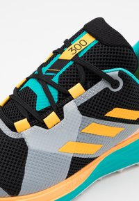 adidas Performance - TERREX TWO LIGHTSTRIKE RUNNING SHOES - Obuwie do biegania Szlak - hi-res aqua/core black/solar gold - 5