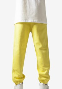 Urban Classics - SWEATPANTS SP. - Tracksuit bottoms - yellow - 1