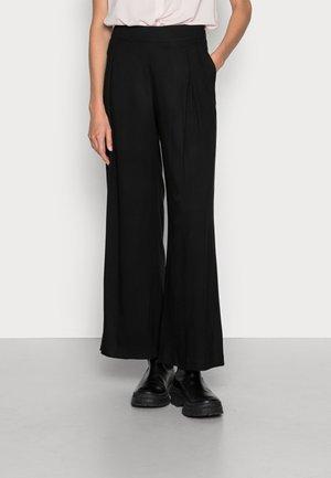 TUNDRA - Trousers - black