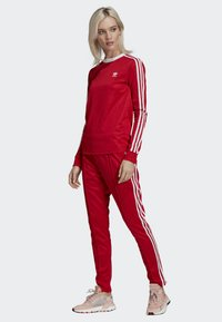 adidas Originals - SST TRACKSUIT BOTTOMS - Tracksuit bottoms - red - 1
