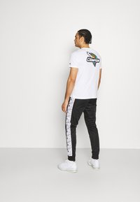 Champion - CUFF PANTS - Tracksuit bottoms - black