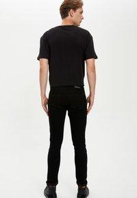 DeFacto - Slim fit jeans - black - 2