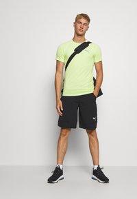 Puma - EVOSTRIPE TEE - Camiseta básica - sharp green - 1