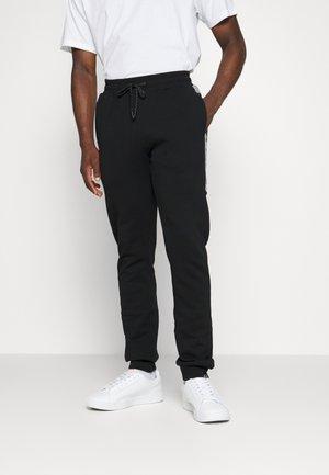 PLEIADIES JOG PANT - Spodnie treningowe - black