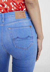 Kings Of Indigo - MARIE - Flared Jeans - blue denim - 5