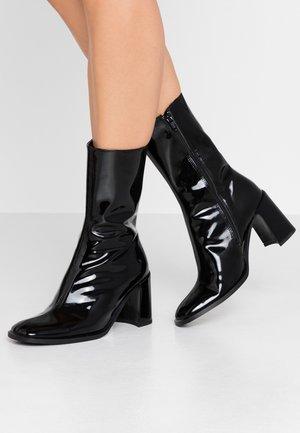 ASTA - Kotníkové boty - black