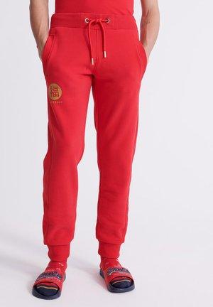 ORANGE LABEL - Pantalon de survêtement - rebel red