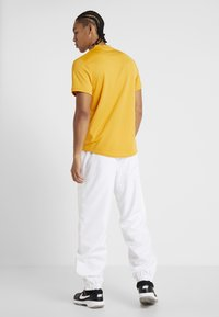 Lacoste Sport - TENNIS PANT - Tracksuit bottoms - white - 2
